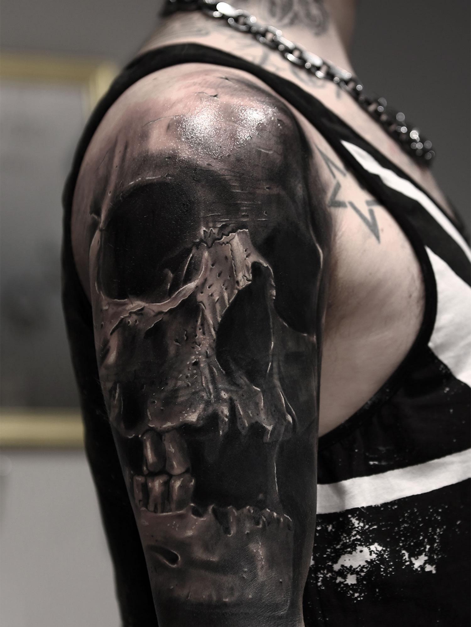 Black Skull Tattoo On Upper Full Arm For Men