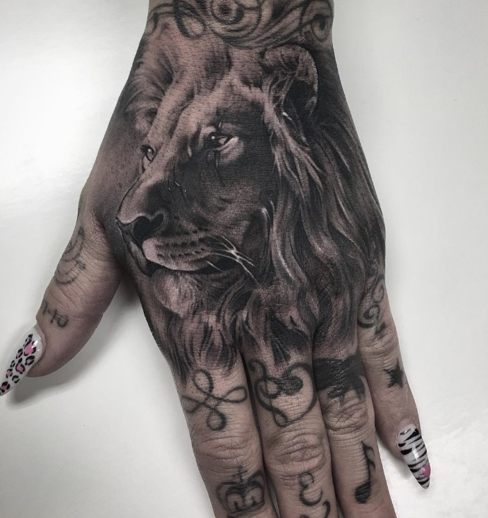 Grey Shaded Lion Tattoo On Girl S Hand