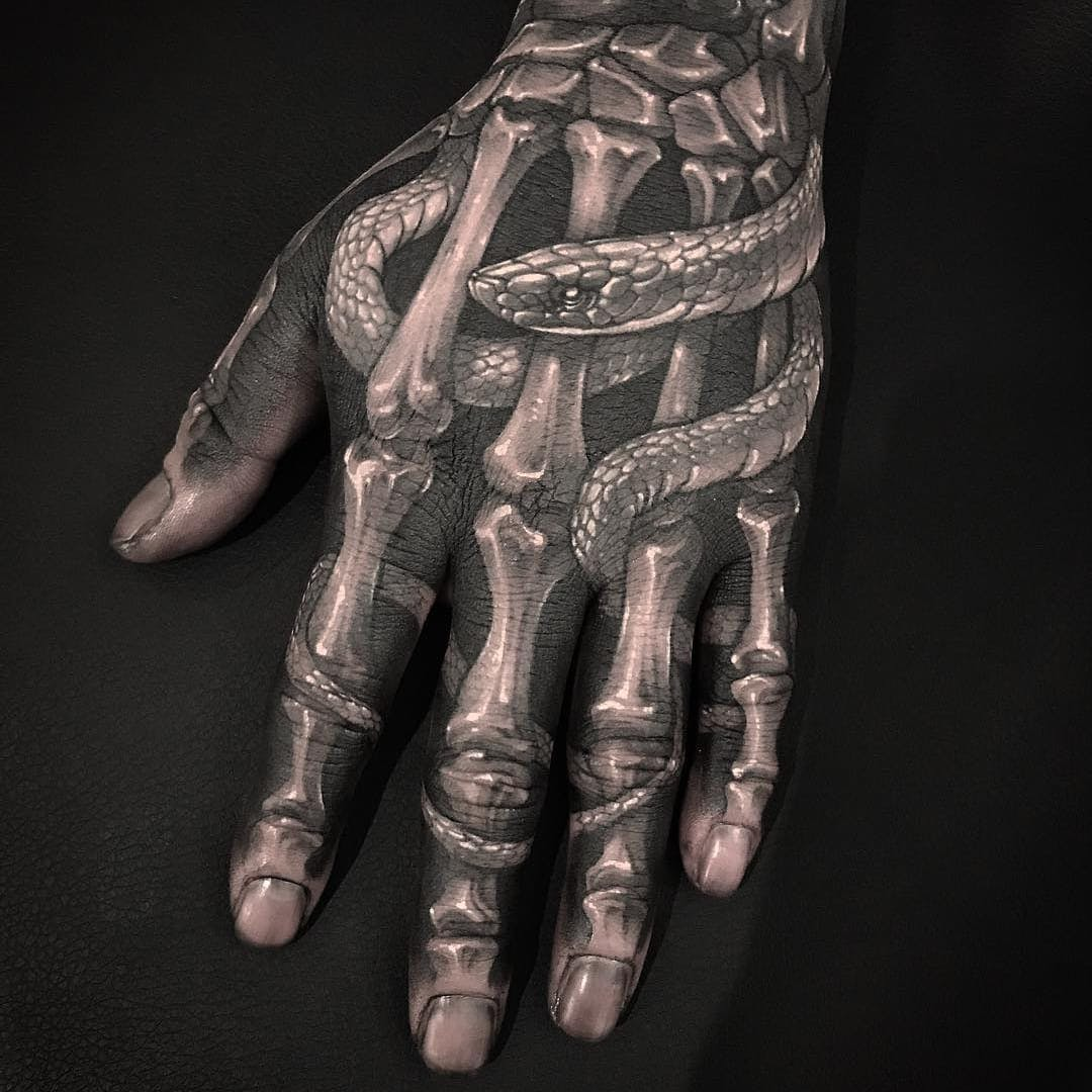 9cc5e5cc8fd5f Black and grey shaded skeleton with snake tattoo on full upper hand