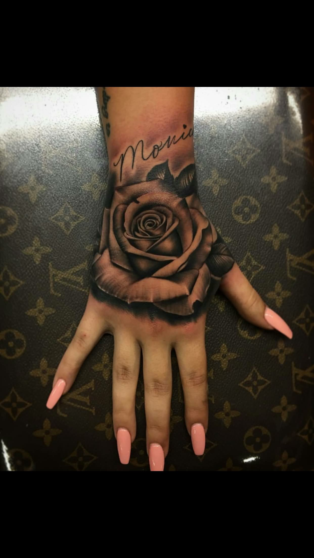 Black Shaded Rose Tattoo On Upper Hand