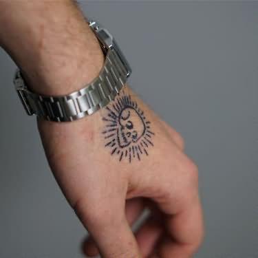 9c04960f1 Black small skull tattoo on upper hand