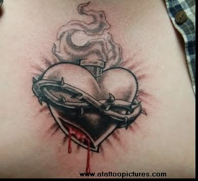 Black and grey shaded barbed wire broken heart tattoo on body
