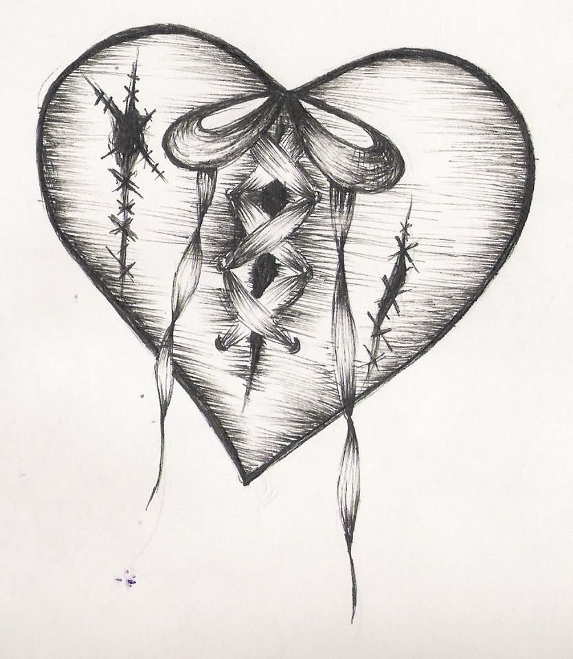 Black and grey shaded sewed broken heart tattoo design