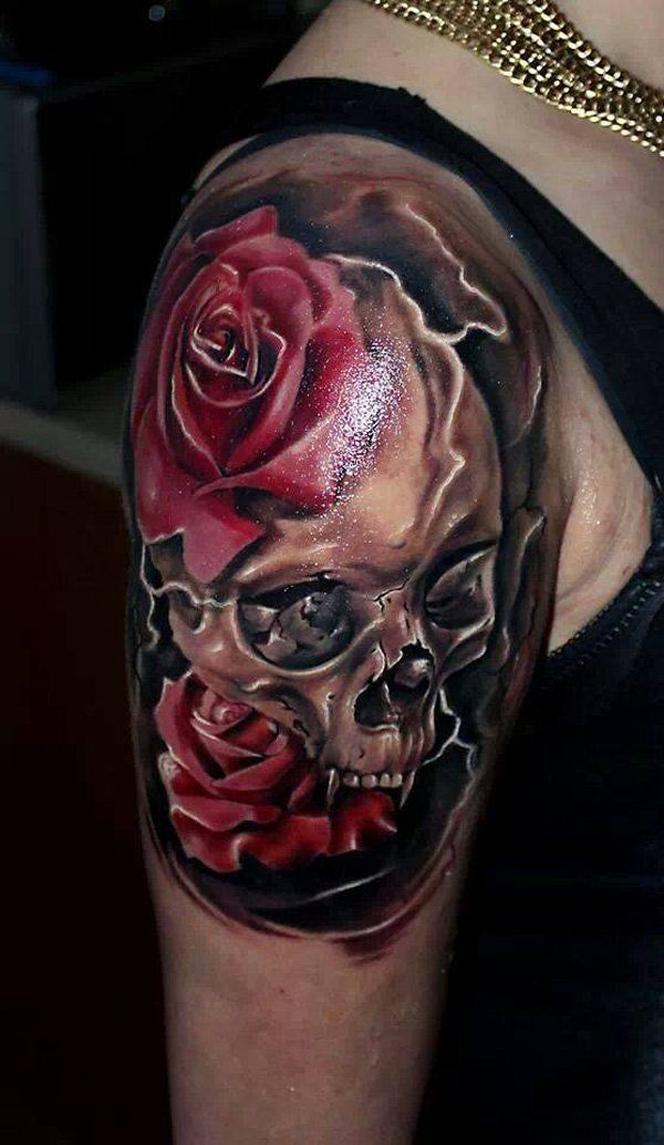 Black And Red Roses And Skull Tattoo On Upper Arm For Women
