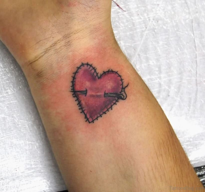 Black and red sewed broken heart tattoo on wrist