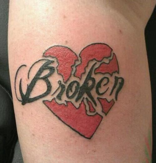 Black and red texted broken heart tattoo on body