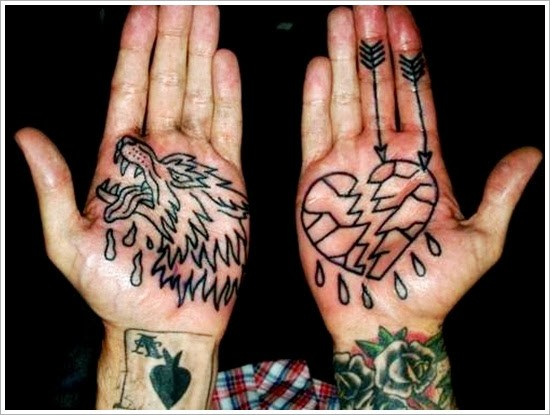 Black outlined shattered broken heart with arrow and droplets tattoo on right hand