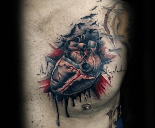 Black realistic broken heart with birds tattoo on chest for men