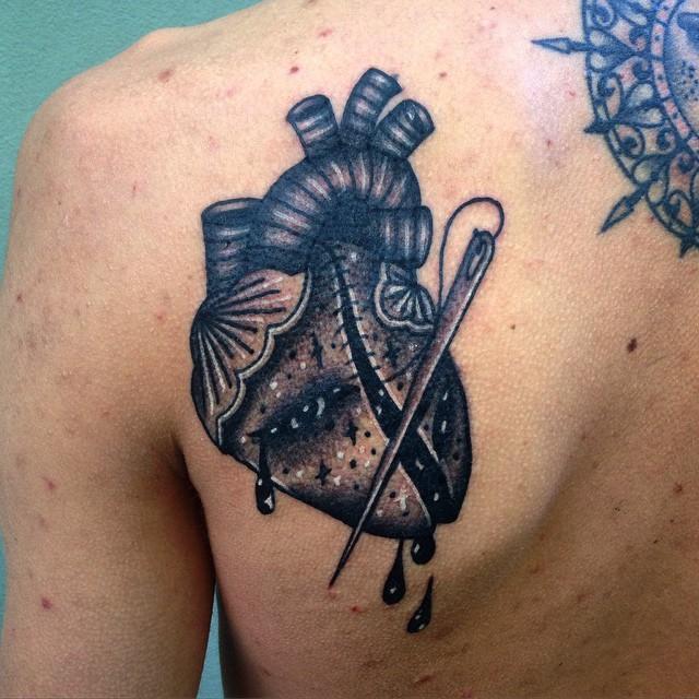Black sewed broken real heart tattoo on left upper back by Aivaras Ly