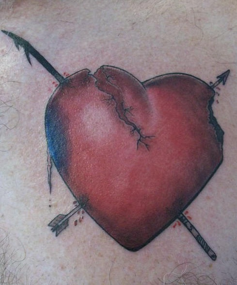Black and red cracked broken heart with arrows tattoo on body