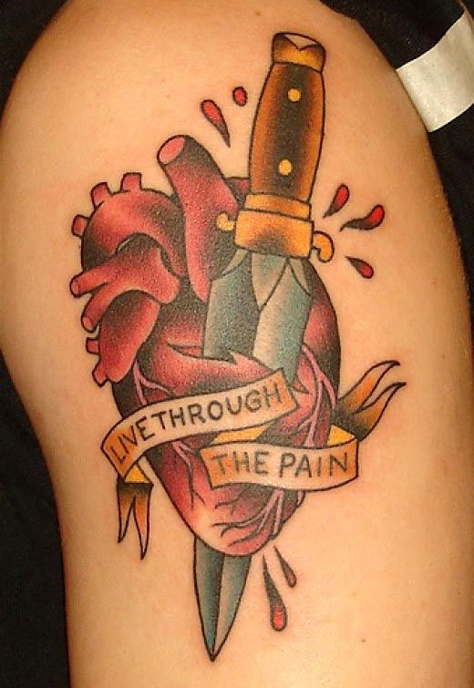 Colored broken heart with sword tattoo on arm