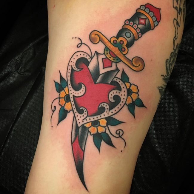 Colored traditional sword broken heart tattoo on arm