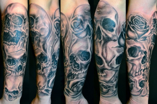 55249ef26 Grey shaded skull with rose tattoo on lower full sleeve