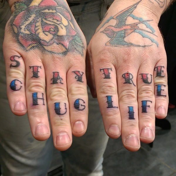 5fcb90c42 Red and blue colored stay true thug life wording knuckle tattoo
