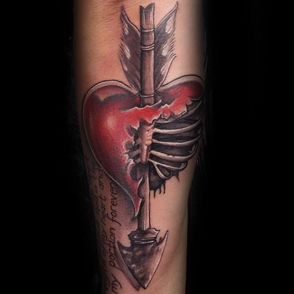 Red and grey shaded rib cage arrow broken heart tattoo on inner forearm