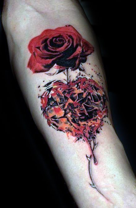 Red rose broken shattered heart tattoo on arm