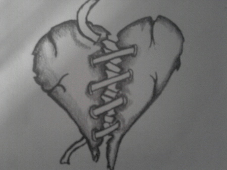 Grey shaded sewed heart tattoo design